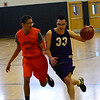 KRISTOPHER RADDER - BRATTLEBORO REFORMER<br /> Brattleboro's Jacob Williams tries to get around Middlebury's Jeb Plooffe during a basketball game on Wednesday, April 11, 2018.