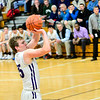 KRISTOPHER RADDER — BRATTLEBORO REFORMER<br /> Brattleboro's Hunter Beebe takes a jump shot  during a boys varsity game at Brattleboro Union High School on Tuesday, Dec. 18, 2018.