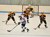 KRISTOPHER RADDER - BRATTLEBORO REFORMER<br /> Brattleboro's Axis Baisley skates through Burr & Burton's defense during a hockey game on Saturday, Dec. 10, 2016.