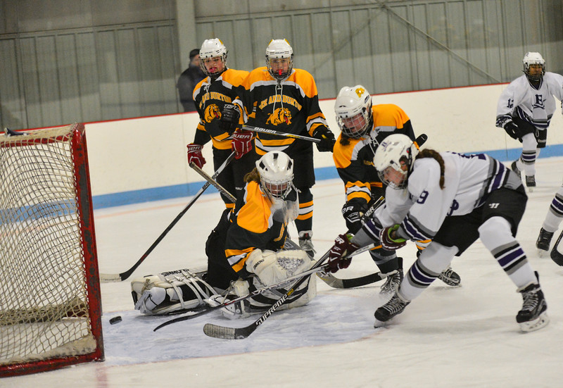 KRISTOPHER RADDER - BRATTLEBORO REFORMER<br /> Brattleboro's Edie Cay taps the puck in for the first goal during a hockey game against Burr & Burton on Saturday, Dec. 10, 2016.