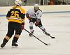 KRISTOPHER RADDER - BRATTLEBORO REFORMER<br /> Brattleboro's Sarah LaPorte lines up to take a shot on goal during a hockey game against Burr & Burton on Saturday, Dec. 10, 2016.