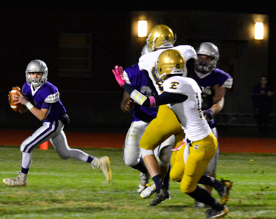 . Brattleboro\'s Tyler Millerick looks for an open player to throw the ball to during a football game against Essex at Brattleboro Union High School on Friday, Oct. 14, 2016. Kristopher Radder / Reformer Staff