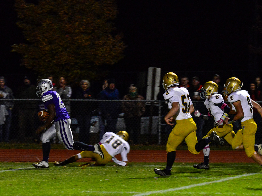 . Brattleboro\'s Cheick Diakite runs the ball 37 yards for the only touchdown during a football game against Essex at Brattleboro Union High School on Friday, Oct. 14, 2016. Kristopher Radder / Reformer Staff