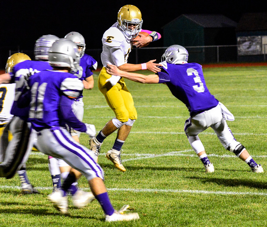 . Brattleboro\'s Kris Carroll tries to tackle Essex\'s Tyler Millette during a football game at Brattleboro Union High School on Friday, Oct. 14, 2016. Kristopher Radder / Reformer Staff
