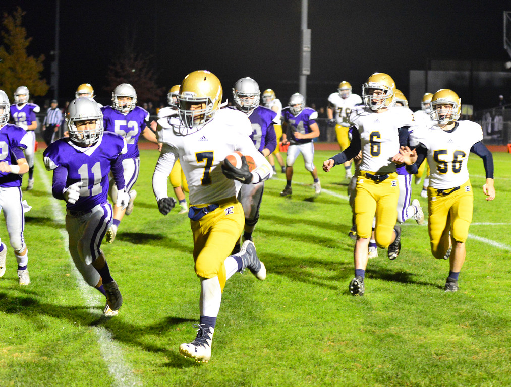. Essex\'s Jordan Hines runs the ball in for a touchdown during a football game at Brattleboro Union High School on Friday, Oct. 14, 2016. Kristopher Radder / Reformer Staff