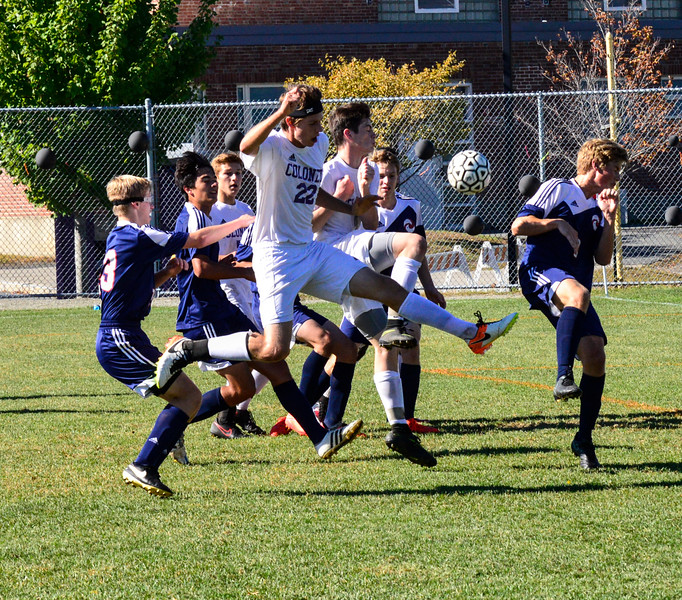Brattleboro's Jackson Buettner leaps into the air to kick the ball for the first goal against Hartford during a match at Brattleboro Union High School on Saturday, Sept. 24, 2016. Brattleboro would win 3-2. Kristopher Radder / Reformer Staff