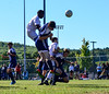 Brattleboro's Jasper Reed leaps into the air while Hartford's Cody Williams heads the ball into his own goal during a match at Brattleboro Union High School on Saturday, Sept. 24, 2016. Brattleboro would win 3-2.  Kristopher Radder / Reformer Staff
