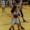 KRISTOPHER RADDER - BRATTLEBORO REFORMER<br /> Brattleboro's Brianna Legacy looks for an open player during a basketball game against Mt. Anthony Union on Thursday, Feb. 23, 2017. Brattleboro would win 47-42.