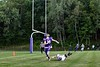 Brattleboro's Aaron Petrie hits the ground aftering trying to take down Terrier TE, Dylan Clark, as he eyes an incoming pass during the season opener at BFUHS August 30, 2019.