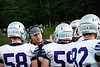 Brattleboro coach, Mike Empey, offers advice to his players at the season opener in Bellows Falls August 30.