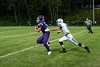 Brattleboro's Aaron Petrie attempts to take down Vancor McGregor as he runs towards a touchdown during the season opener at BFUHS on August 30.
