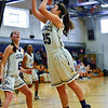 KRISTOPHER RADDER - BRATTLEBORO REFORMER<br /> Brattleboro's Gabrielle Carpenter takes an attempt during a girls' varsity basketball game against Burlington at Brattleboro Union High School on Saturday, Jan. 7, 2017.