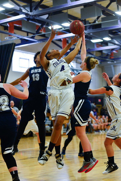KRISTOPHER RADDER - BRATTLEBORO REFORMER<br /> Brattleboro's Shenise Taliaferro gets the offensive rebound during a girls' varsity basketball game against Burlington at Brattleboro Union High School on Saturday, Jan. 7, 2017.