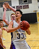 KRISTOPHER RADDER - BRATTLEBORO REFORMER<br /> Brattleboro's Eli Lombardi looks for an open shot during a boys' basketball game at Brattleboro Union High School on Tuesday, Dec. 13, 2016.