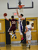 KRISTOPHER RADDER - BRATTLEBORO REFORMER<br /> Brattleboro's Eli Lombardi blocks the shot by Monument Mountain's Joe Aberdare during a boys' basketball game at Brattleboro Union High School on Tuesday, Dec. 13, 2016.