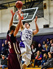 KRISTOPHER RADDER - BRATTLEBORO REFORMER<br /> Brattleboro's Eli Lombardi makes a fade away shot while being covered by Monument Mountain's Joe Aberdare during a boys' basketball game at Brattleboro Union High School on Tuesday, Dec. 13, 2016.