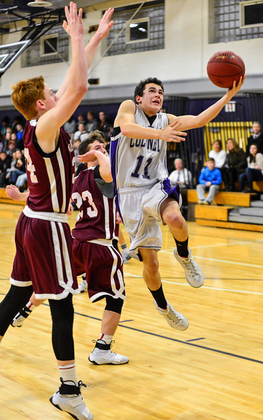 KRISTOPHER RADDER - BRATTLEBORO REFORMER<br /> Brattleboro's Ian Fulton-Black gets around Monument Mountain's Connor Prince to take an attempt during a boys' basketball game at Brattleboro Union High School on Tuesday, Dec. 13, 2016.