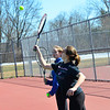 KRISTOPHER RADDER - BRATTLEBORO REFORMER<br /> Alissa Walkowiak and Holden Hiler serve the ball during practice on Monday, March 26, 2018.