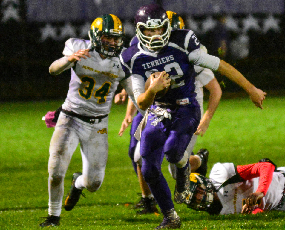 . Bellows Falls\' Shane Clark runs the ball for a first down during a football game at Bellows Falls Union High School on Friday, Oct. 21, 2016. Burr and Burton remains prefect after beating Bellows Falls 34-14. Kristopher Radder / Reformer Staff