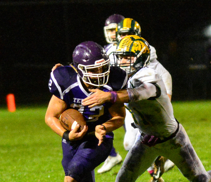. Burr and Burton\'s Griffin Stalcup tackles Bellows Falls\' Jacob Lober during a football game at Bellows Falls Union High School on Friday, Oct. 21, 2016. Burr and Burton remains prefect after beating Bellows Falls 34-14. Kristopher Radder / Reformer Staff