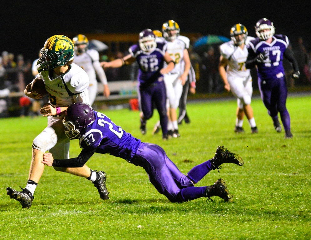 . Bellows Falls\' Brody Burke tries to stop Burr and Burton\'s Carter Vickers during a football game at Bellows Falls Union High School on Friday, Oct. 21, 2016. Burr and Burton remains prefect after beating Bellows Falls 34-14. Kristopher Radder / Reformer Staff
