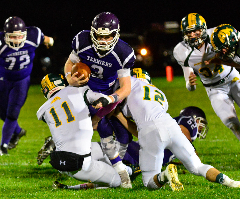 . Bellows Falls\' Logan Cota tries to get past Burr and Burton\'s Griffin Stalcup and Sean Apps during a football game at Bellows Falls Union High School on Friday, Oct. 21, 2016. Burr and Burton remains prefect after beating Bellows Falls 34-14. Kristopher Radder / Reformer Staff