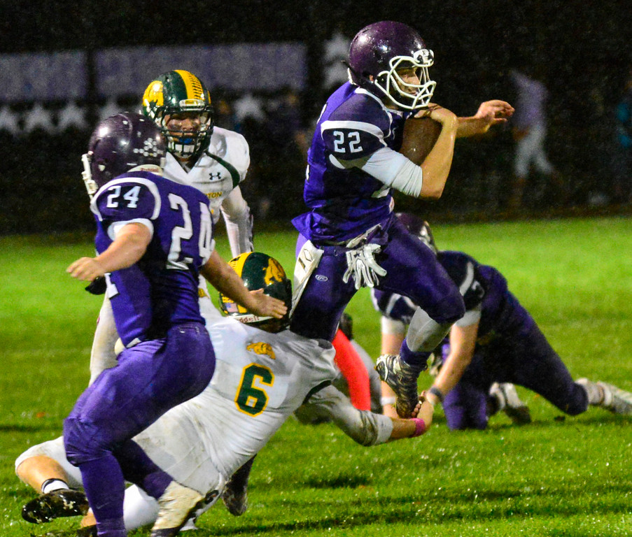 . Bellows Falls; Shane Clark weaves through Burr and Burton\'s defense during a football game at Bellows Falls Union High School on Friday, Oct. 21, 2016. Burr and Burton remains prefect after beating Bellows Falls 34-14. Kristopher Radder / Reformer Staff