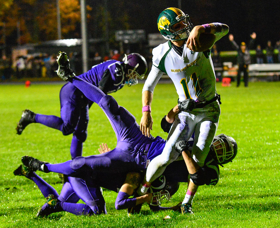 . Burr and Burton\'s Griffin Stalcup plows through Bellows Falls defense for the first touchdown during a football game at Bellows Falls Union High School on Friday, Oct. 21, 2016. Burr and Burton remains prefect after beating Bellows Falls 34-14. Kristopher Radder / Reformer Staff