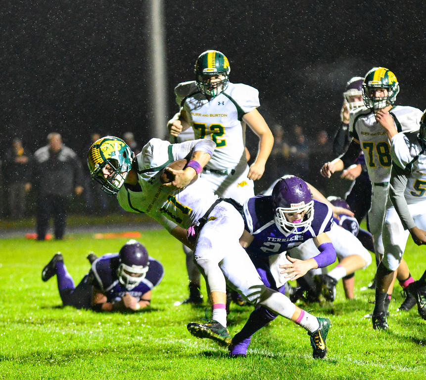 . Burr and Burton\'s Griffin Stalcup plows through Bellows Falls defense for a touchdown during a football game at Bellows Falls Union High School on Friday, Oct. 21, 2016. Burr and Burton remains prefect after beating Bellows Falls 34-14. Kristopher Radder / Reformer Staff