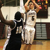 Abington's Wesley Rines fires a jumper over Council Rock North'sJohn Raymon.<br /> Bob Raines 1/25/11