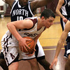 Abington's Chris Ruhl takes control of a loose ball under the basket before going up for a shot against Council Rock North's John Raymon.<br /> Bob Raines 1/25/11