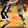 Abington's Jordan Simmons starts a drive against Council Rock North's Arron Goodman only to past to the outside..<br /> Bob Raines 1/25/11