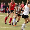 FH_UD CBE_5213  Upper Dublin's Emily Hitchings drives for the Central Bucks East crease, trailed by Katt Miller.     Bob Raines 10.24.11