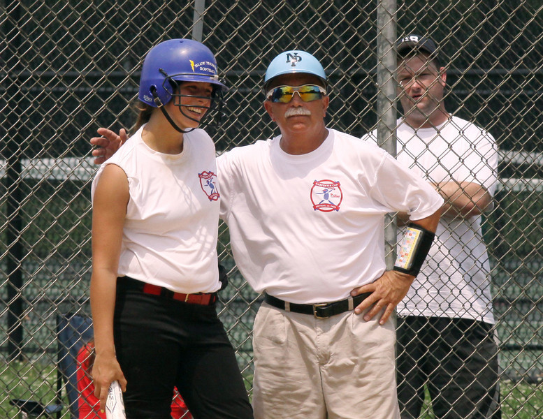 Coach Rick Torresani intructs batter Jessica D'Agostino from Central Bucks West.