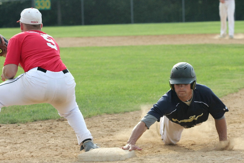 Archbishop Wood's Eric Bowren beats the throw to Souderton's John Santoianni at first base.