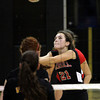 Archbishop Carroll's sets up a spike against Archbishop Wood.
