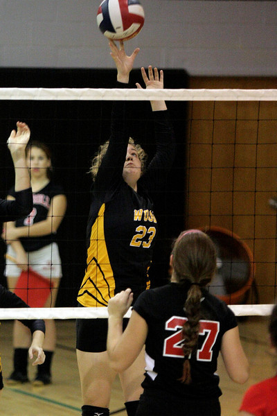 Archbishop Wood's Jenna Acheson taps the ball over the net.