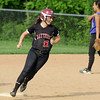 A smiling Val Sadowl rounds second base on her way home after batting a grand slam. Central Bucks South intentionally walked two Hatboro Horsham batters after Melissa Spinosa doubled, loading the bases in hopes of an easy force to end the inning.<br /> Bob Raines 5/12/11