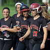 Hatboro Horsham's Val Sadowl gets congratualtions from an excited Melissa Spinosa as the team heads for the post-game lineup ritual with Central Bucks South.<br /> Bob Raines 5/12/11