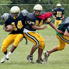 Dan Rouse skirts behind defender Xavier D'Hurieux, who is disposing of an offensive blocker.<br /> Bob Raines 8/25/10