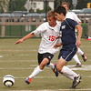 Upper Dublin's Michael Connolly and Cheltnham's Kristos Yiantsos battle for the ball.<br /> Montgomery Media staff photo by Bob Raines <br /> 9/7/11