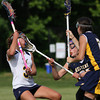Cheltenham's Liza Brazil checks Wissahickon's Samantha Stutman. Emily Leibovitz assists on defense.<br /> Bob Raines 5/7/10