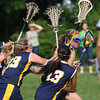 Wissahickon's Laura Frankenfield skirts Cheltenham defenders Steena Chandarath,Alex Norpel1 and Rachel Boles.<br /> Bob Raines 5/7/10