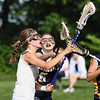 Wissahickon's Aubrey Bossert takes a shot as Cheltenham's Emily Rose tries to check.<br /> Bob Raines 5/7/10