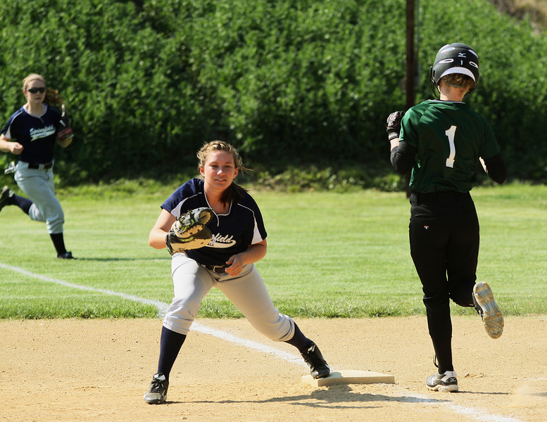 Springfield's Kelsea Shagrin makes the force on Chrisopher Dock's Lillian Nicholas at first base.
