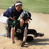 Christopher Dock's Lillian Nicholas scores before Springfield catcher Bridget Bennis can make the tag.