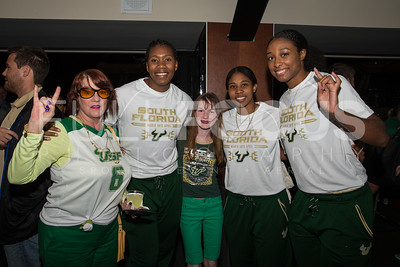 South Florida Bulls center Nancy Warioba (32), forward Shandrea Leverett (21), and  forward Jazz Bond (3) take a photo with fans during the NCAA selection party at the Sun Dome on March 13, 2017 in Tampa, Florida.