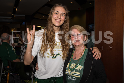 South Florida Bulls guard/forward Ariadna Pujol (11) poses with a fan for a photo during the NCAA selection party at the Sun Dome on March 13, 2017 in Tampa, Florida.