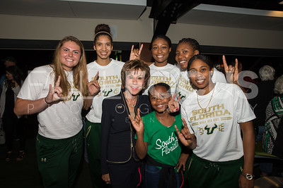 South Florida Bulls center Alyssa Rader (54), forward Jazz Bond (3), guard Nachalie De Jesus (20), center Nancy Warioba (32), and South Florida Bulls forward Shandrea Leverett (21) pose with President. Dr. Judy Genshaft during the NCAA selection party at the Sun Dome on March 13, 2017 in Tampa, Florida.
