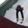 KRISTOPHER RADDER - BRATTLEBORO REFORMER<br /> With the reflection of the inrun on the shield, Jacob Fuller goes down the hill for his first jump in the Men's U.S. Cup division at the Harris Hill Ski Jump, in Brattleboro, Vt., on Saturday, Feb. 17, 2018.